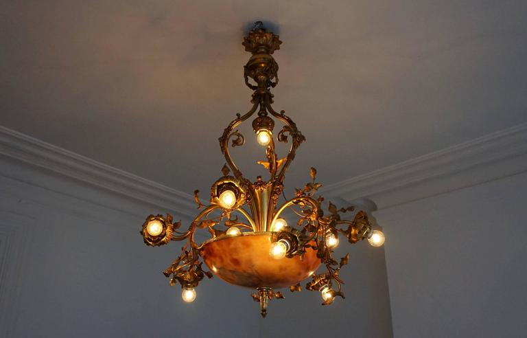 A fine bronze and alabaster Belle Époque chandelier, shaped as swirling and flowering rose branches, early 20th century.