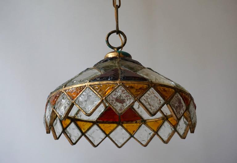 Rare colored stained glass chandelier.   Measure:  Total height with the chain is 125 cm. The diameter is 52 cm. The weight is 14 kg.