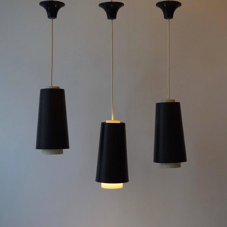Set of three metal pendant lights.