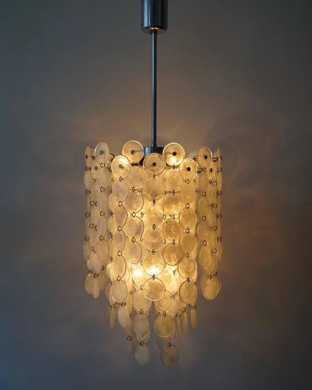 Italian Murano glass chandelier. The light requires ten single E14 screw fit lightbulbs (40Watt max.) LED compatible.  Measures:  Total height 110 cm. Diameter 38 cm. Height of the lamp without the grid is 60 cm.