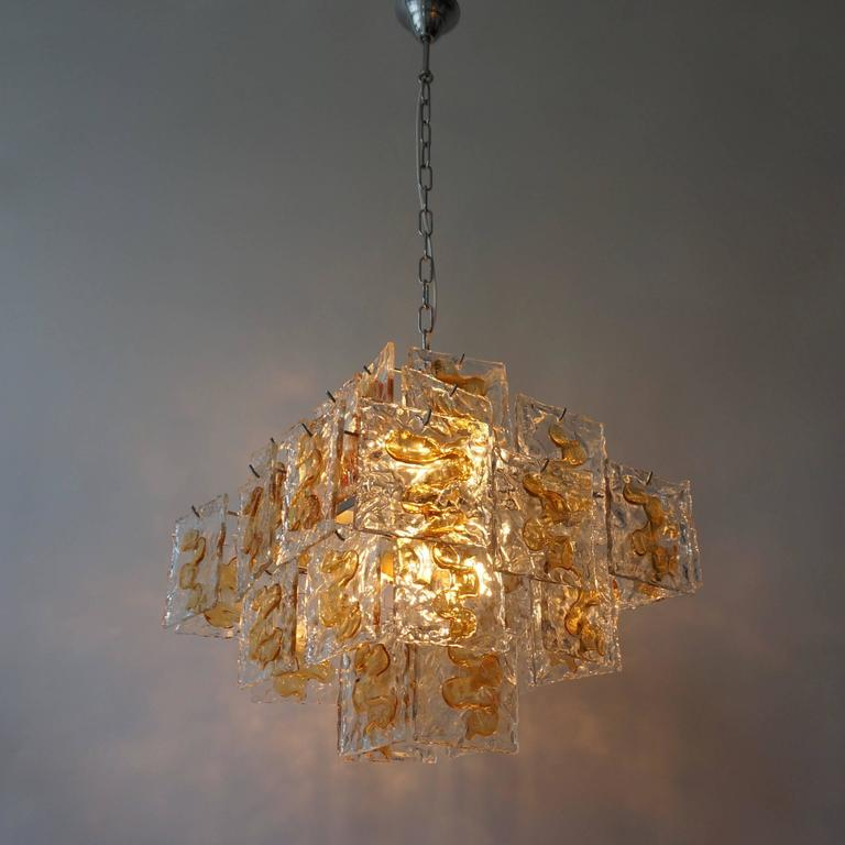 Italian Murano glass chandelier by Mazzega. Total height with the chain is 110 cm. Eight E14 bulbs.