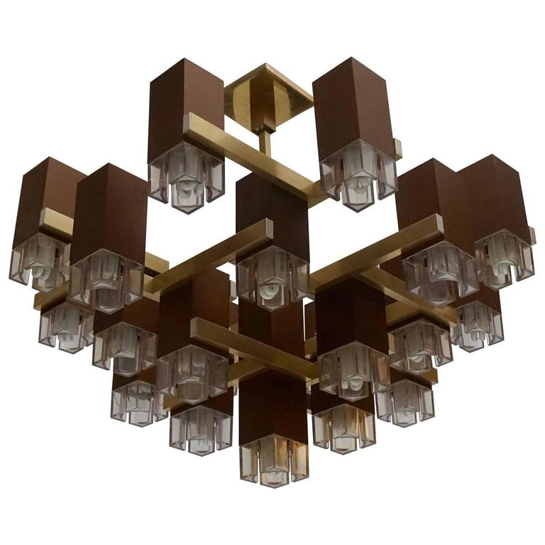 Pristine Sciolari 20 cubic lacquered brass chandelier, 1970s, Italia.