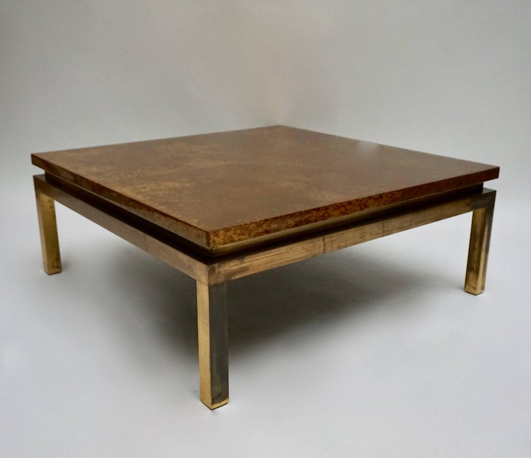 An Italian Mid-Century Modern coffee table having gold gilt foil and ebonize lacquer decorated top supported on metal legs, circa 1960 - 1970s. Weight 27 kg.