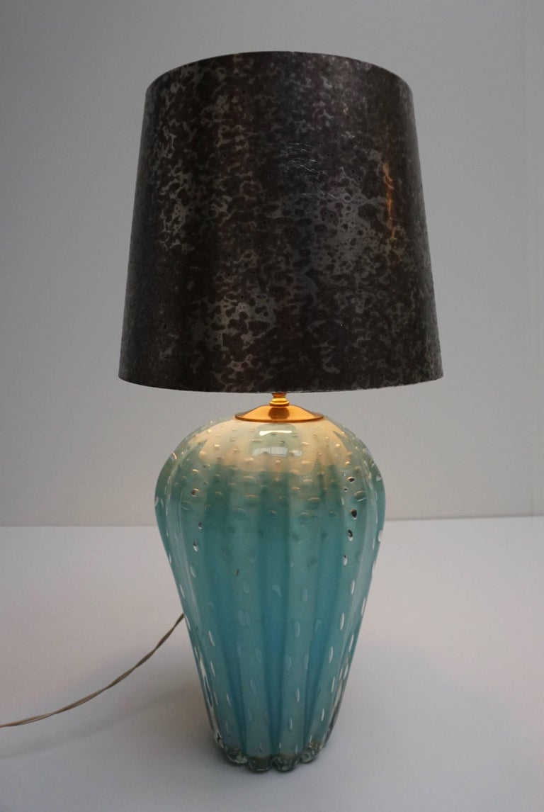 Italian Murano glass table lamp. The lampshade is not included in the price. Diameter glass base is 22 cm. Diameter shade is 30 cm. Height glass base is 32 cm. Height glass base with fitting is 40 cm. Total height with the shade is 61 cm.