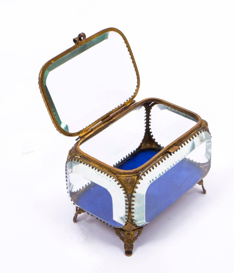 This is a delightful antique French ormolu and glass mounted rectangular wedding casket circa 1880 in date.  This wonderful casket, is ornamented with ormolu floral motifs and mounted on four gilt scroll feet. The base of the casket is lined with