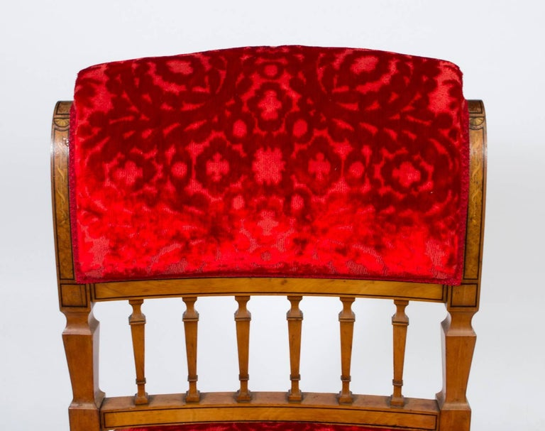 This is a lovely antique Victorian nursing chair, circa 1880 in date, made from solid satinwood and beautifully inlaid.