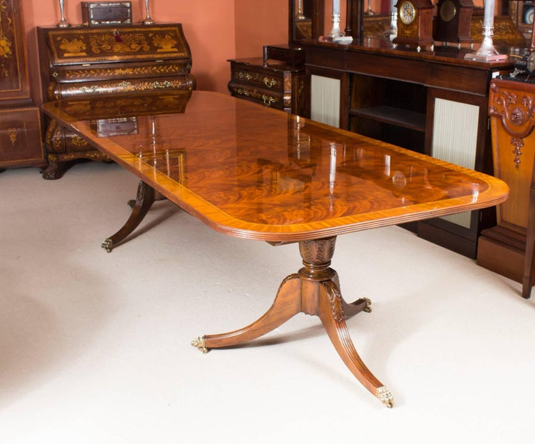 Flame mahogany regency style dining table and ten chairs at 1stdibs for Regency furniture living room sets
