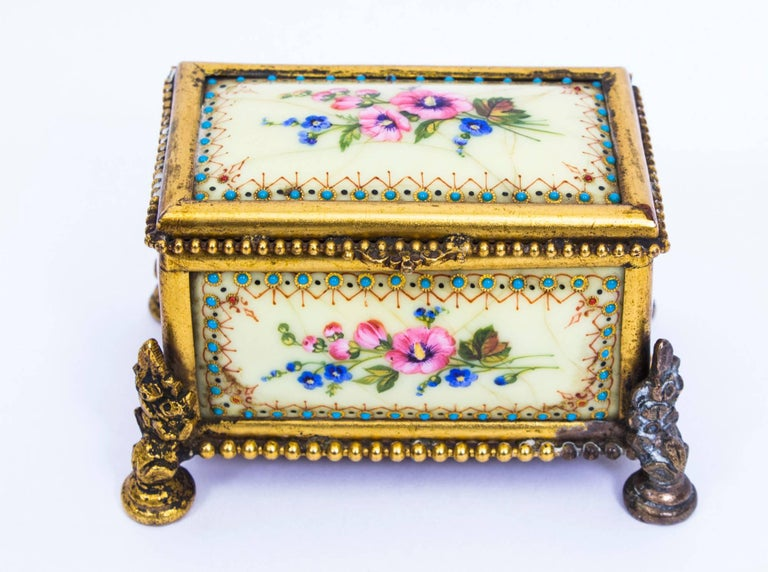 This is a beautiful antique French Limoges ormolu-mounted enamel rectangular bombe' shaped table casket, circa 1870.