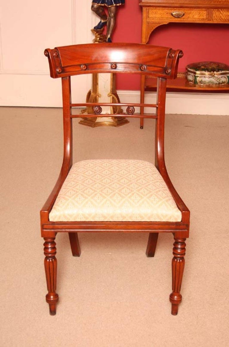 Grand english regency mahogany dining table and ten chairs at 1stdibs for Regency furniture living room sets