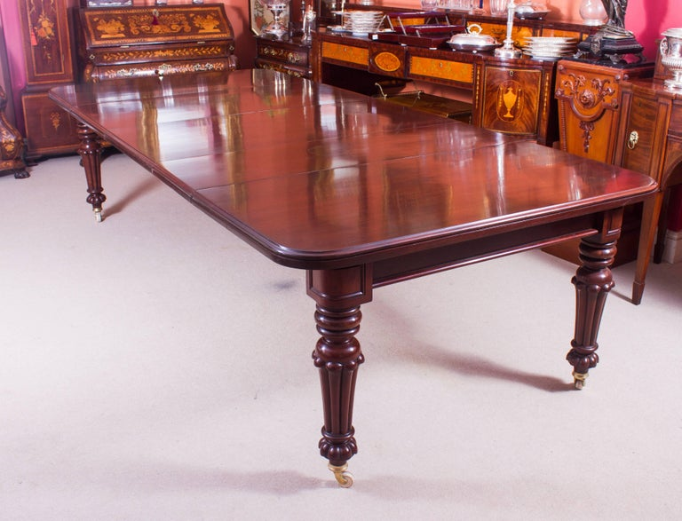 19th century flame mahogany extending dining table and 12 for 12 person dining table for sale