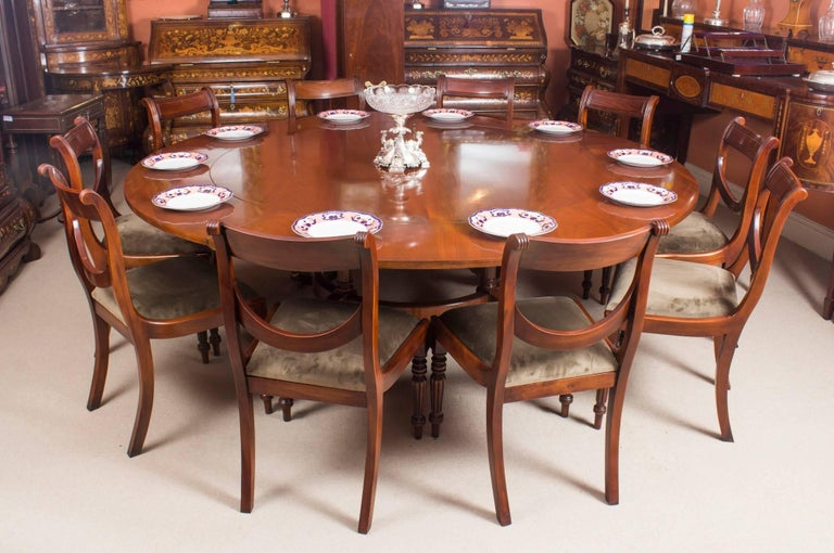 Vintage Mahogany Jupe Dining Table, Leaf Cabinet and Ten Chairs