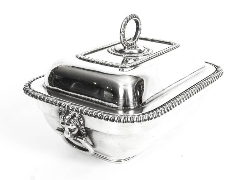 This is an exquisite and rare antique pair of English silver plate sauce tureens, Circa 1860 in date.  They are of the highest quality, in excellent condition and are ready to grace your dining table, they bear the makers mark of the renowned