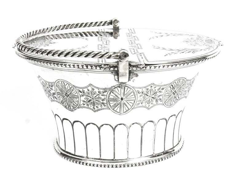 This is a gorgeous antique Victorian silver plated sweet basket, C 1860.  Practical and stylish, this is sure to get noticed when in use, or on display. It bears the marks of the Victorian silversmith Hamilton & Laidlaw on the underside.  This