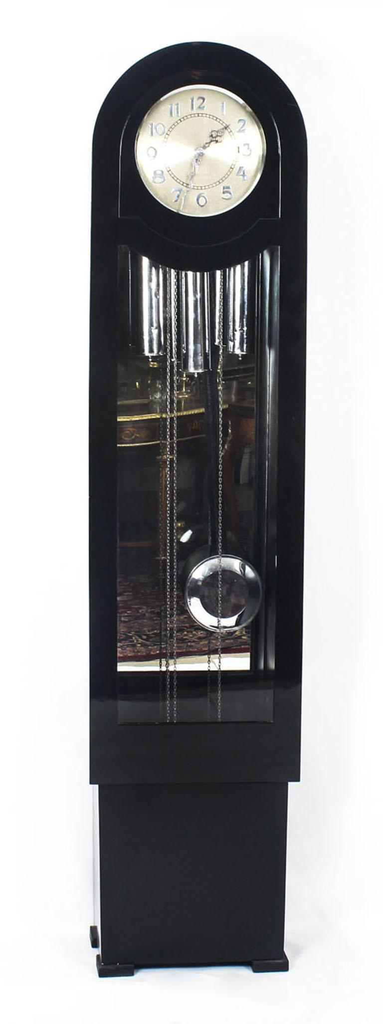 An elegant English Art Deco black lacquer Westminster chiming longcase clock made in London, circa 1935 in date.
