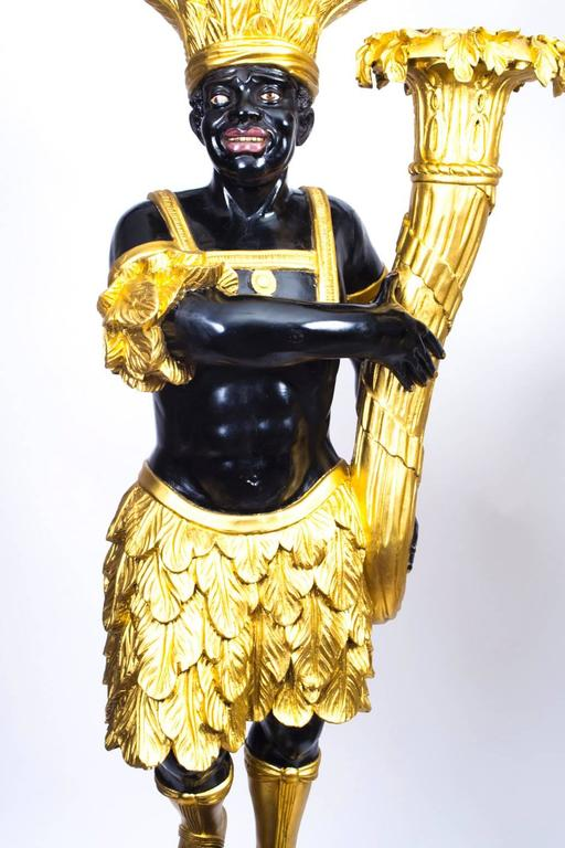 https://a.1stdibscdn.com/archivesE/upload/f_9506/f_50943431468329243704/07362_Antique_Pair_190cm_Giltwood_Venetian_Blackamoor_Late_18th_C_5_l.jpg