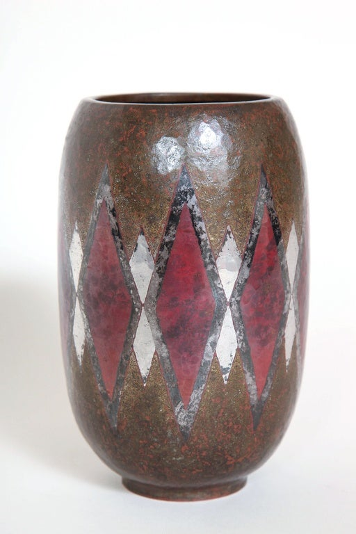 Cylindrical copper and maillechort dinanderie vase with a geometric design.  Impressed underneath Cl Linossier.  Literature: Jean Gaillard,
