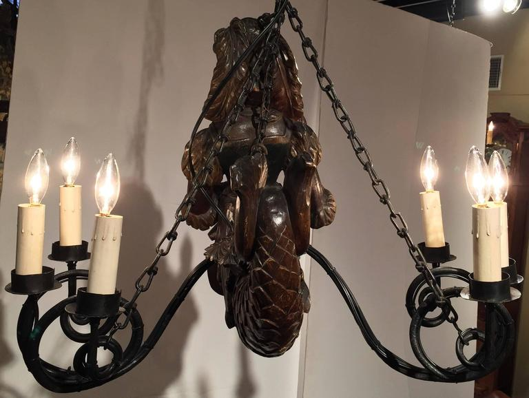 Iron 19th Century German Lusterweibchen Carved Walnut Polychrome Six-Light Chandelier For Sale