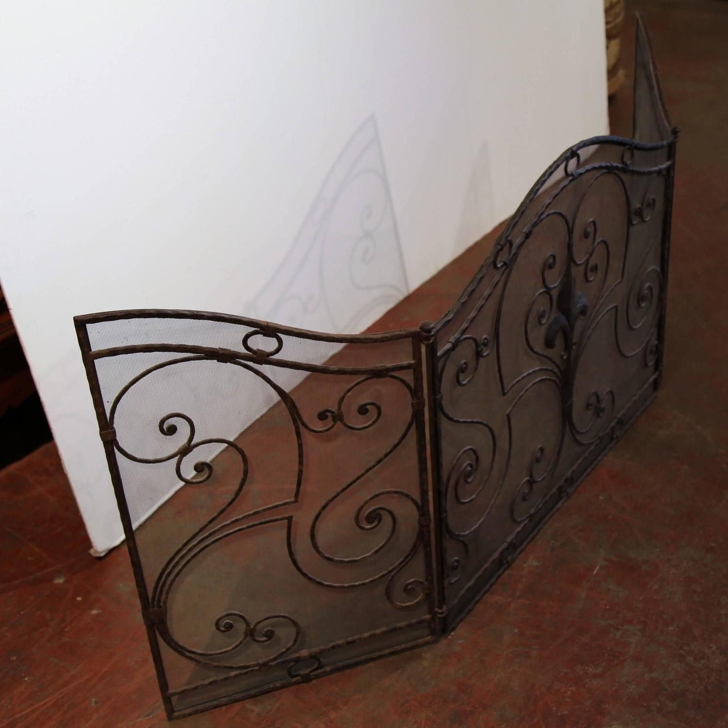 wrought iron fireplace screen with fleur de lis at