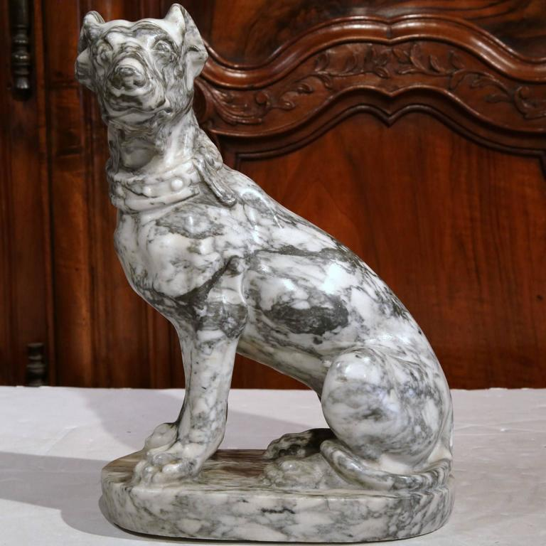 Elegant antique marble dog figure from France carved, circa 1870, the animal sculpture in a seated position on an oval base, features a carved collar around the neck. Excellent condition with intricate detail work, wonderful proportions and rich