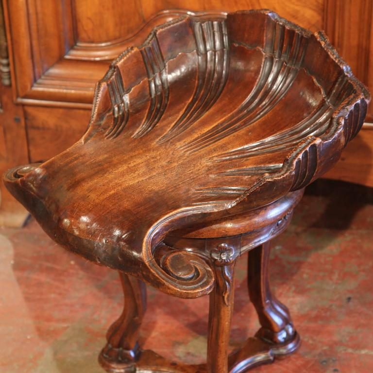 This carved antique fruitwood grotto stool was created in France, circa 1850. Perfect as a piano stool or simply a statement piece, the seat has a