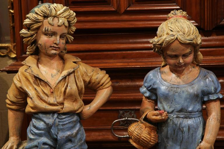Hand-Painted Pair of 20th Century French Hand Painted Boy and Girl Iron Sculptures For Sale