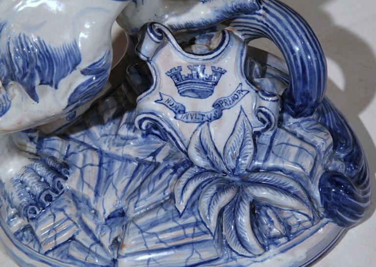 Embellish your desktop or a bookshelf with this large, antique hand-painted blue and white faience lion standing sculpture. Sculpted in Nancy, France, circa 1870, this piece resembles a Classic delft style with blue and white colors. The proud lion
