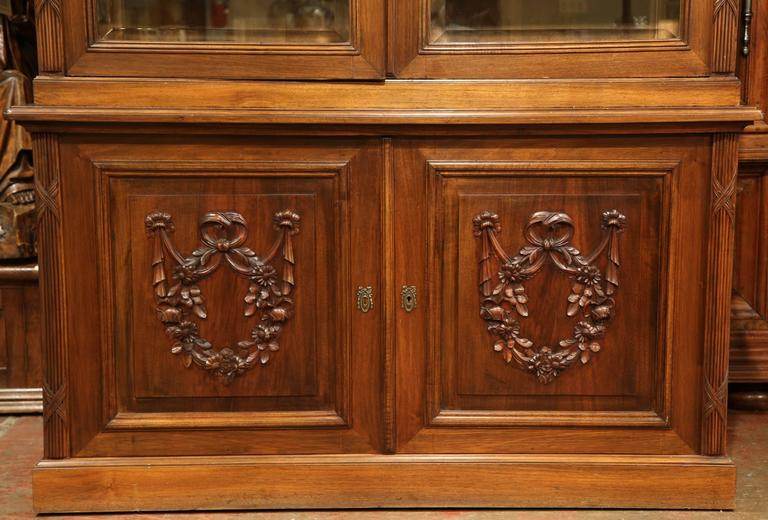 Tall Early 20th Century French Carved Walnut Bookcase With