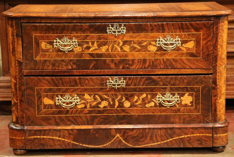 Add beautiful storage to your home with this antique chest of drawers from Italy, circa 1820. The ornate commode features wonderful marquetry work on both sides, top and front, with elegant motifs including a bird, butterfly, flower vases, leaves