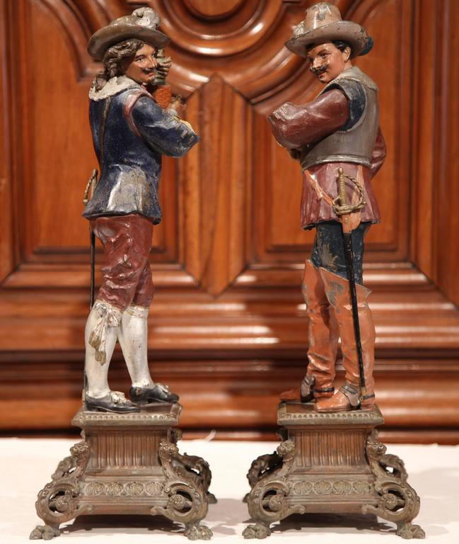 Hand-Painted Pair of 19th Century French Spelter Hand Painted Musketeer Figures on Stand For Sale