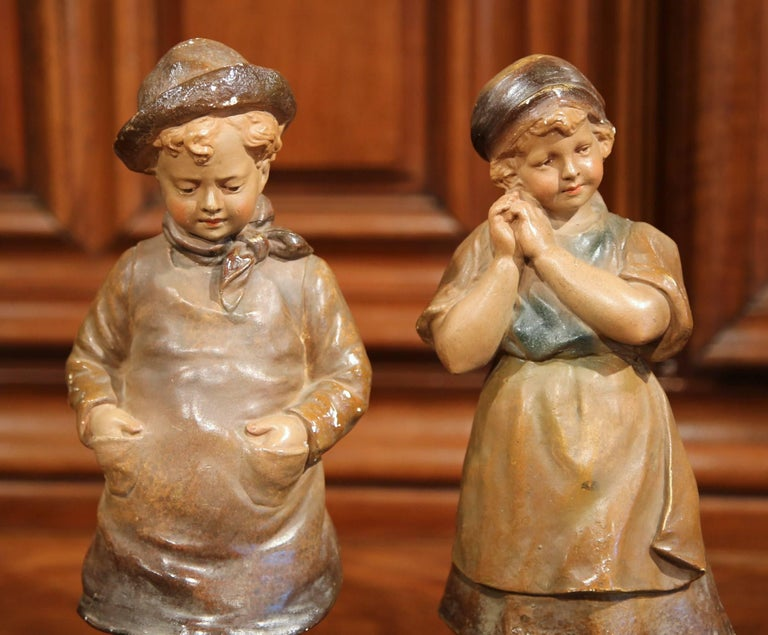 These antique terracotta figurines were created in France, circa 1920. Each figure depicts a young child from Victor Hugo's French Revolution historical novel