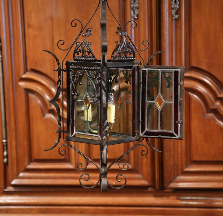Hand-Crafted 19th Century French Napoleon III Black Iron Lantern with Stained Glass Panels For Sale