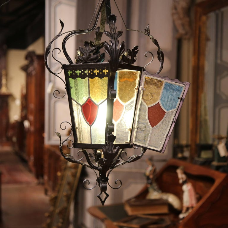 Hand-Crafted 19th Century, French Napoleon III Black Iron Lantern with Stained Glass Panels For Sale