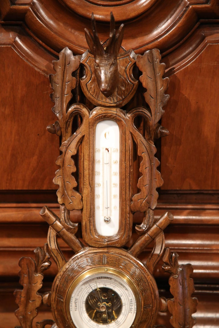 Patinated 19th Century French Carved Walnut Black Forest Barometer with Deer and Gun Decor For Sale