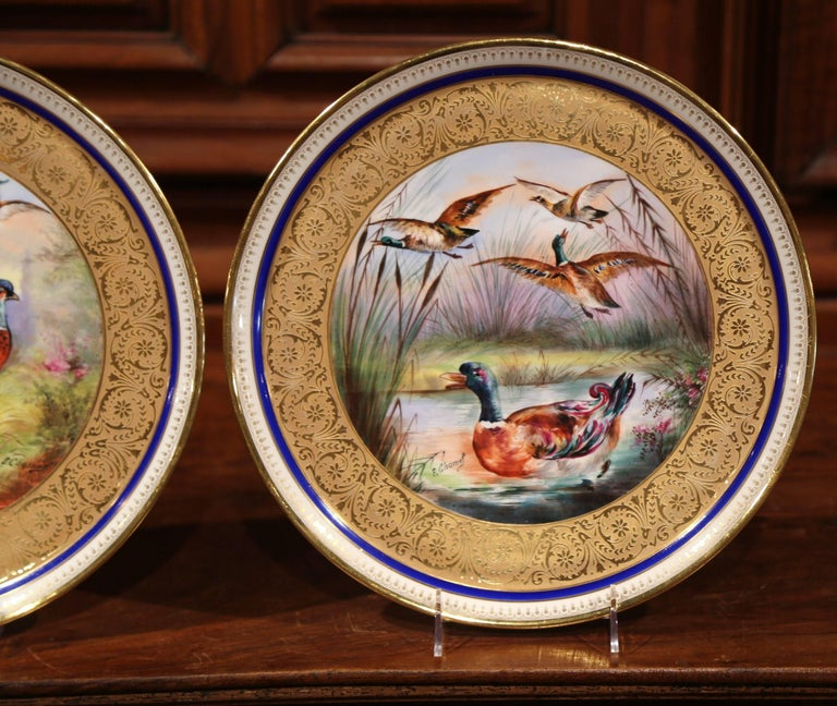Gilt Pair of 19th Century French Hand-Painted Porcelain Plates with Duck and Peacock For Sale