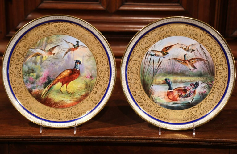 Pair of 19th Century French Hand-Painted Porcelain Plates with Duck and Peacock In Excellent Condition For Sale In Dallas, TX
