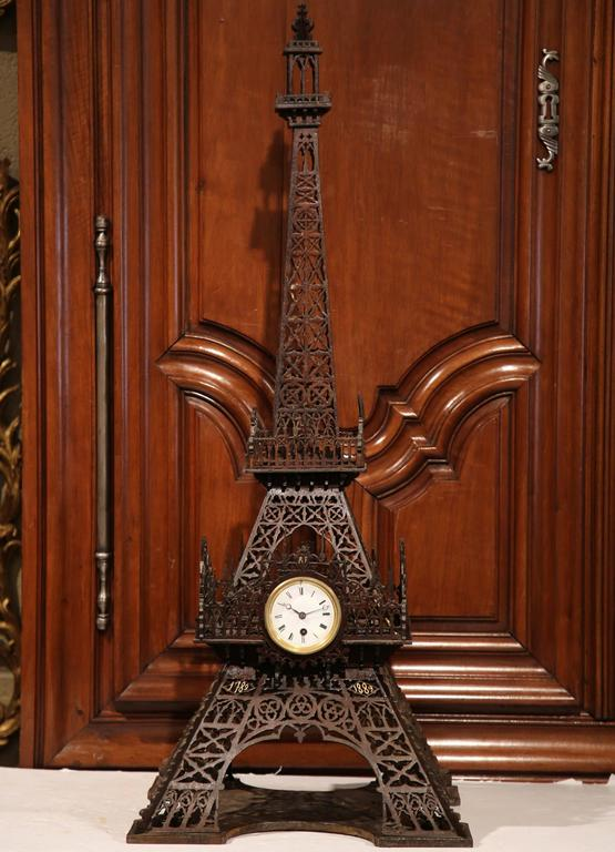 Decorate a shelf or mantel with this grand, antique, carved replica of the Eiffel Tower. Crafted in France circa 1890, the symbolic, intricate architectural symbol is embellished with the original centre clock; the movement has been cleaned and