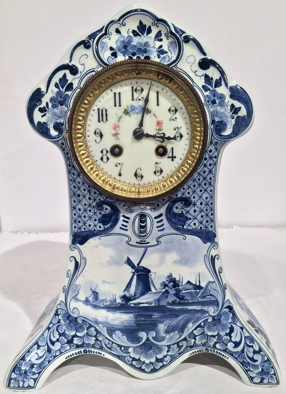 Complete your mantel or desk with this antique, hand-painted mantel clock. Created in Holland, circa 1880, the time keeper has its original clock mechanism, which has been professionally cleaned and checked. The table clock has a brass rim around