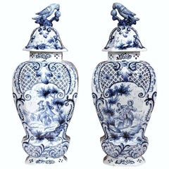 Pair of 19th Century Hand-Painted Blue and White Delft Vases with Lids