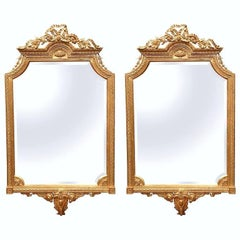 Pair of Mid-20th Century Louis XVI Carved Giltwood Mirrors with Bevelled Glass