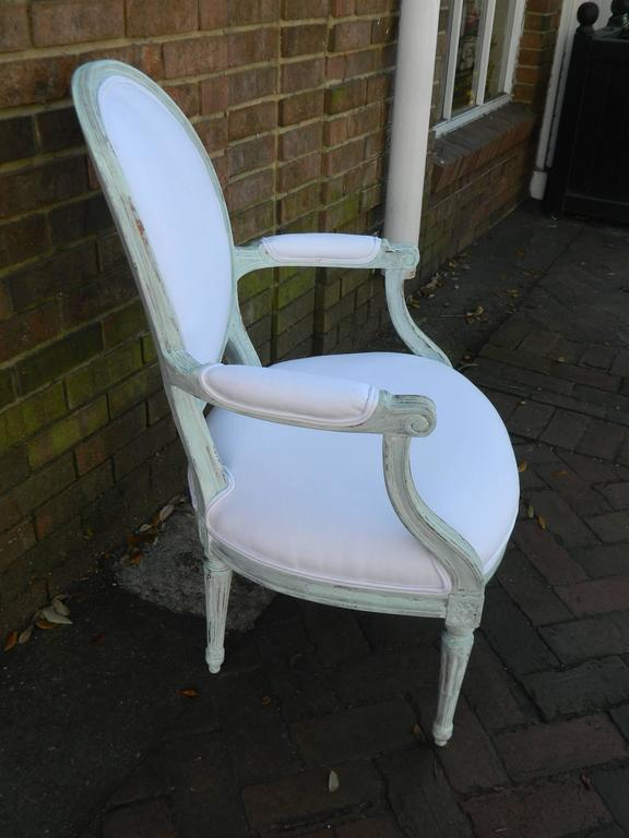 French Pair of Louis XVI Style Painted Open Armchairs, Early 20th Century For Sale