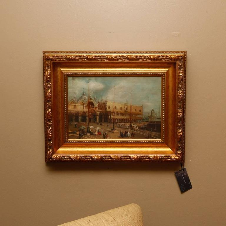 Unsigned early 20th century oil on board depicting the Doge's Palace done in the Grand Tour School. It is housed in a later giltwood frame that measures 21.5 inches wide by 17 inches high. The image size is 14 inches wide by 10 inches high.