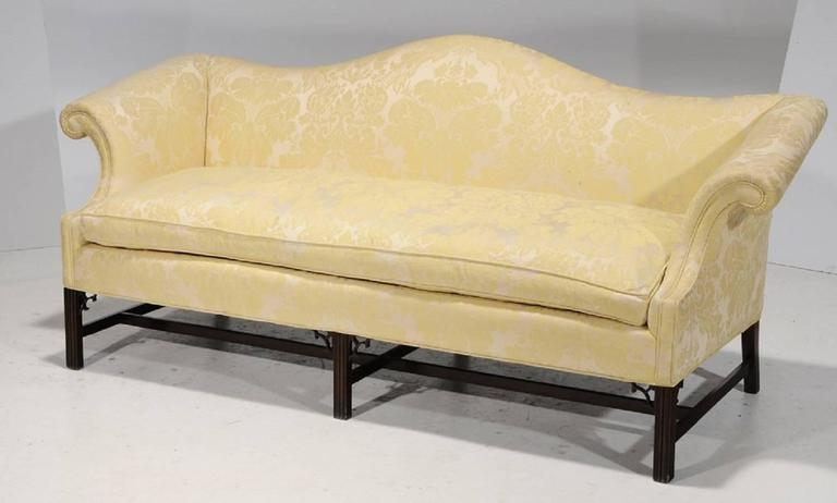 Chippendale Style And Upholstered Camelback Sofa And Down