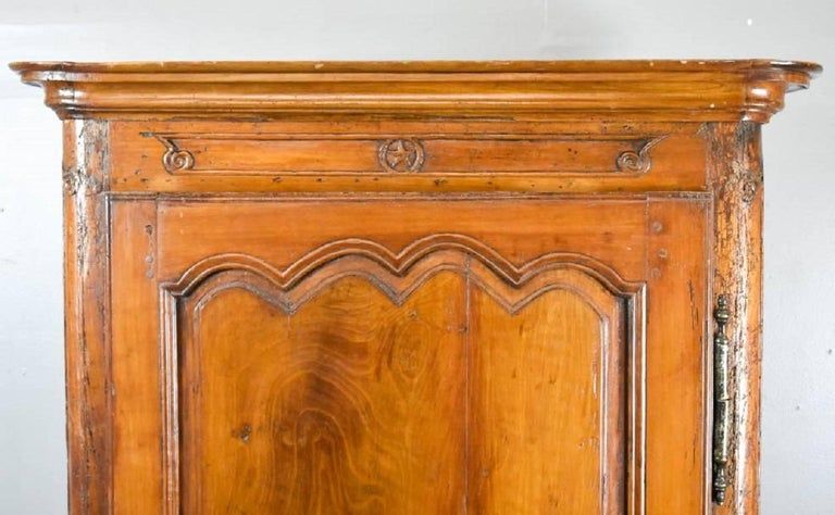 French Provincial Louis XV Fruitwood Bonnetiere, 18th century. Interior has been modified to hold a tv.