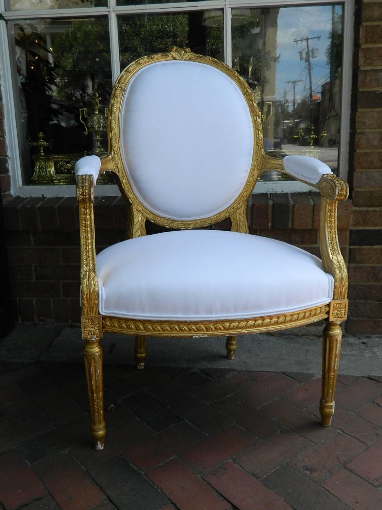 Pair of Louis XVI style giltwood armchairs, 19th century. Upholstered in off-white muslin.
