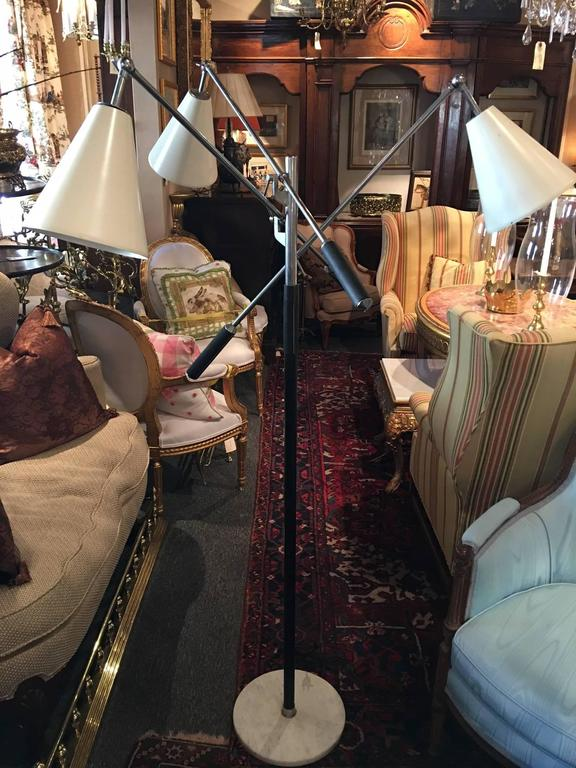 Italian Triennalethree-arm adjustable floor lamp. Handles and pole covered in black leather on a marble base. Stamped on bottom.