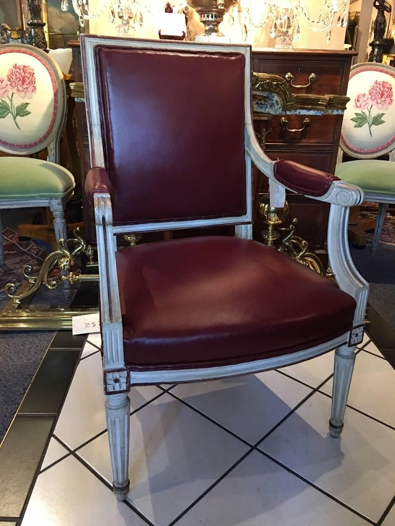 Pair of 19th century Louis XVI style painted fauteuils or armchairs upholstered in leather. Newly upholstered.