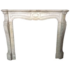 Antique White Marble Fireplace Louis XV Style Volutes, 19th Century, France