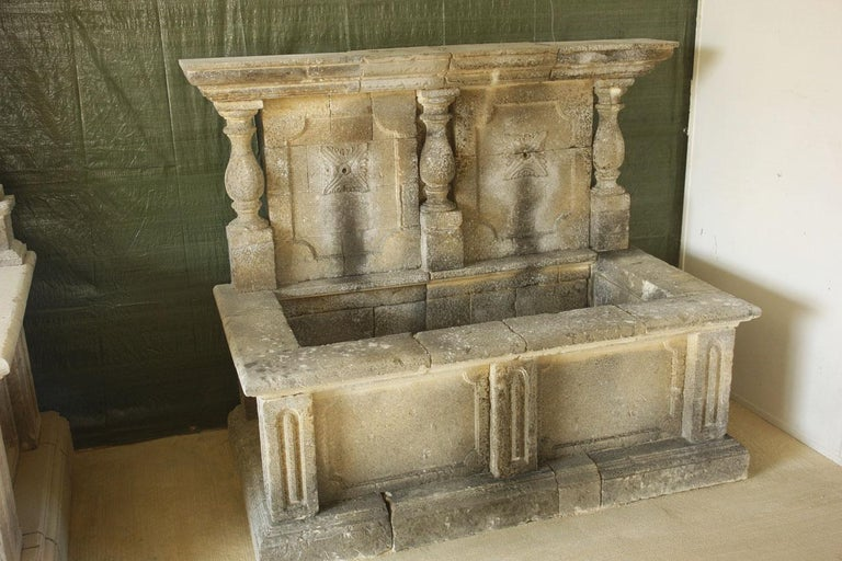 Italian wall fountain 3 columns handcrafted in limestone, late 20th century from Italy. Excellent quality of art work, limestone and finishing. Ready for installation and for use as it is. Measures: High of basin: 23 inches (58.5 cm).