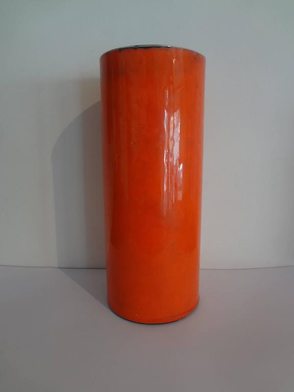 High orange cylinder vase. Georges Jouve, circa 1956. Shiny enamelled cover with a mate black inside. Signed Jouve and Alpha.  Ref : Michel Fare, Georges Jouve Ceramiste, 1965, Modèle p.71g, p.88.