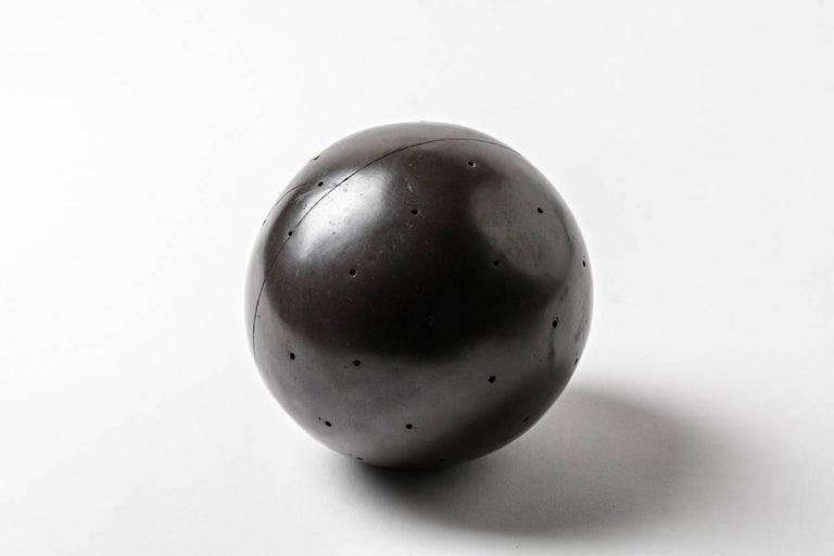 Elegant black spherical abstract ceramic by Nadia Pasquer.